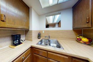 Photo 5: 601 5660 23 Avenue NE in Calgary: Pineridge Row/Townhouse for sale : MLS®# A1134714