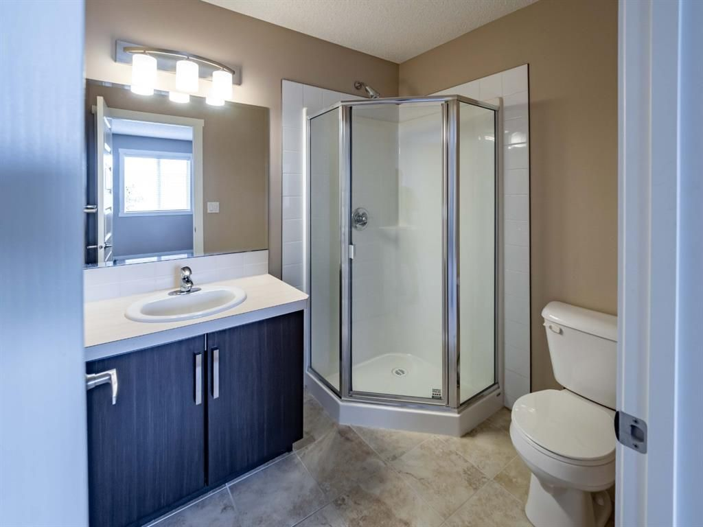 Photo 17: Photos: 544 Mckenzie Towne Close SE in Calgary: McKenzie Towne Row/Townhouse for sale : MLS®# A1128660