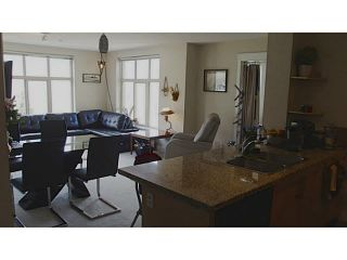 """Photo 5: 411 1211 VILLAGE GREEN Way in Squamish: Downtown SQ Condo for sale in """"ROCKCLIFFE"""" : MLS®# V1097477"""