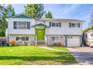 Photo 1: 13311 SUTTON Place in Surrey: Queen Mary Park Surrey House for sale : MLS®# R2561356