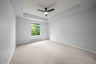 "Photo 14: 312 12464 191B Street in Pitt Meadows: Mid Meadows Condo for sale in ""Laseur Manor"" : MLS®# R2596658"