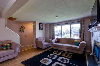 Photo 5: 345 Falshire Drive NE in Calgary: Falconridge Detached for sale : MLS®# A1148106