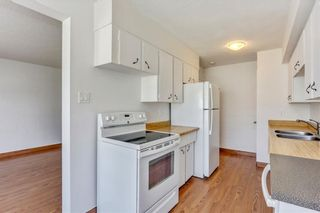 Photo 4: 7 6147 Buckthorn Road NW in Calgary: Thorncliffe Row/Townhouse for sale : MLS®# A1141165