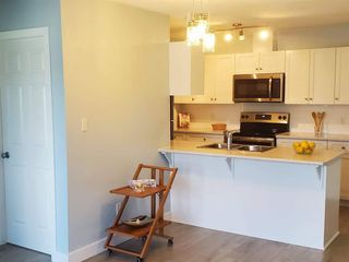 "Photo 8: 407 33960 OLD YALE Road in Abbotsford: Central Abbotsford Condo for sale in ""OLD YALE HEIGHTS"" : MLS®# R2499608"