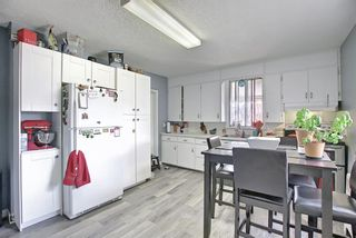 Photo 2: 801 20 Avenue NW in Calgary: Mount Pleasant Duplex for sale : MLS®# A1084565