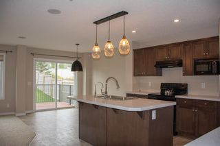 Photo 4: 14 HILLCREST Street SW: Airdrie Detached for sale : MLS®# A1031272