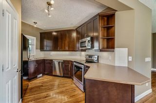 Photo 7: 45 PROMINENCE Park SW in Calgary: Patterson Semi Detached for sale : MLS®# C4249195