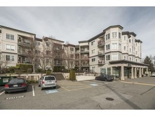 """Photo 1: 109 5765 GLOVER Road in Langley: Langley City Condo for sale in """"COLLEGE COURT"""" : MLS®# R2552863"""