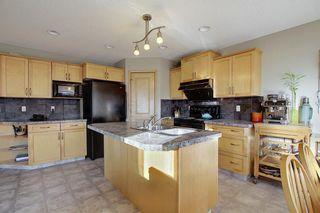 Photo 3: 304 Cranfield Gardens SE in Calgary: Cranston Detached for sale : MLS®# A1050005