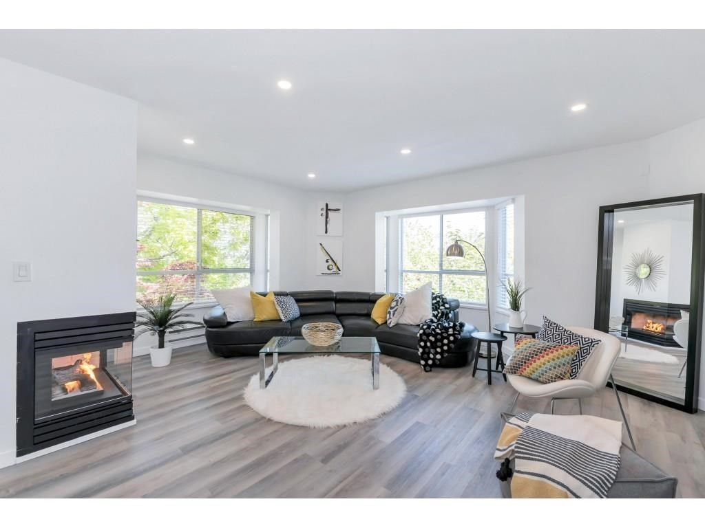 """Main Photo: 325 1952 152A Street in Surrey: King George Corridor Condo for sale in """"Chateau Grace"""" (South Surrey White Rock)  : MLS®# R2580670"""