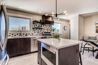 Photo 4: 7412 FARRELL Road SE in Calgary: Fairview Detached for sale : MLS®# A1062617