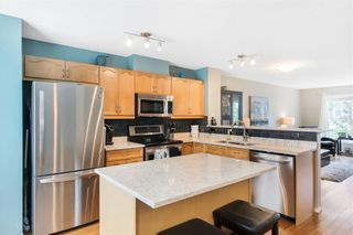 Photo 12: 206 TOSCANA Gardens NW in Calgary: Tuscany Row/Townhouse for sale : MLS®# A1088865