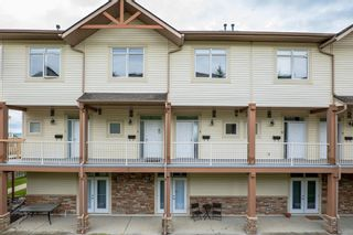 Photo 2: 9 140 Rockyledge View NW in Calgary: Rocky Ridge Row/Townhouse for sale : MLS®# A1118889