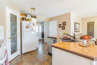 Photo 33: 21 Bow Ridge Crescent: Cochrane Detached for sale : MLS®# A1079980