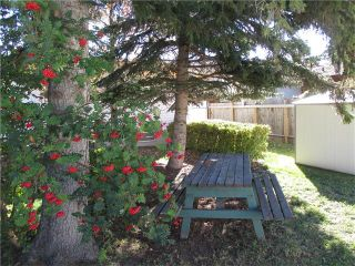 Photo 7: 5707 LAWSON Place SW in Calgary: Lakeview House for sale : MLS®# C4034051
