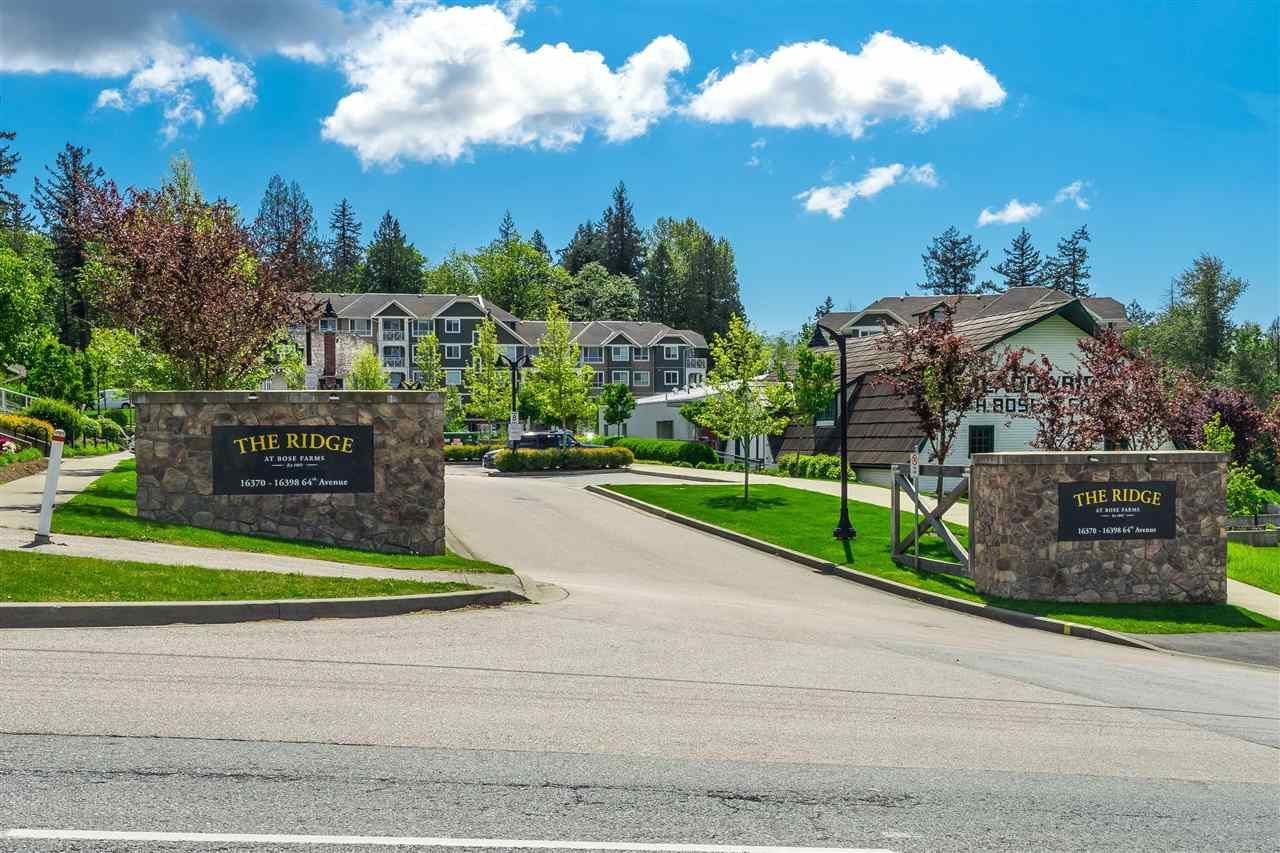 """Main Photo: 410 16380 64 Avenue in Surrey: Cloverdale BC Condo for sale in """"The Ridge at Bose Farms"""" (Cloverdale)  : MLS®# R2573583"""