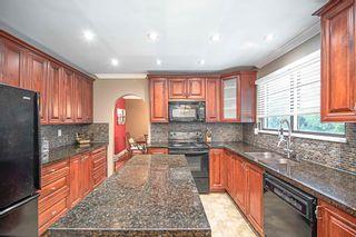 Photo 2: 7730 STANLEY Street in Burnaby: Upper Deer Lake House for sale (Burnaby South)  : MLS®# R2601642