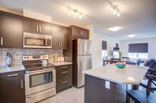 Photo 11: 1001 1225 Kings Heights Way SE: Airdrie Row/Townhouse for sale : MLS®# A1111490