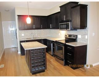 Photo 1: 7696 DAVIES Street in Burnaby: Edmonds BE House for sale (Burnaby East)  : MLS®# V775727