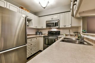 """Photo 9: 106 9865 140 Street in Surrey: Whalley Condo for sale in """"Fraser Court"""" (North Surrey)  : MLS®# R2137812"""