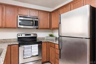 Photo 10: RANCHO SAN DIEGO Condo for sale : 2 bedrooms : 12191 Cuyamaca College Dr E #310 in El Cajon