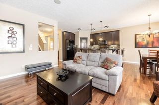 Photo 8: 325 BRIDLERIDGE View SW in Calgary: Bridlewood House for sale : MLS®# C4177139