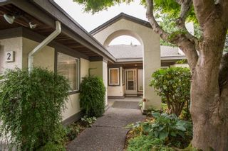 """Photo 1: 2 12941 17TH Avenue in Surrey: Crescent Bch Ocean Pk. Townhouse for sale in """"Ocean Park Grove"""" (South Surrey White Rock)  : MLS®# R2610272"""