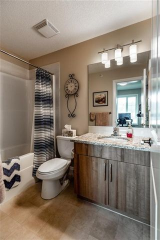 Photo 15: 2408 15 Sunset Square: Cochrane Apartment for sale : MLS®# A1123430