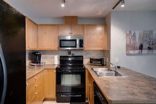 Photo 4: 1302 92 Crystal Shores Road: Okotoks Apartment for sale : MLS®# A1132113