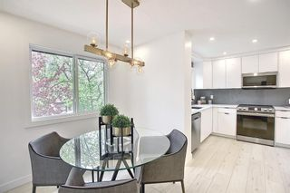 Photo 16: 64 Glamis Gardens SW in Calgary: Glamorgan Row/Townhouse for sale : MLS®# A1112302