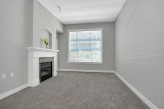 """Photo 3: 107 960 LYNN VALLEY Road in North Vancouver: Lynn Valley Condo for sale in """"Balmoral House"""" : MLS®# R2599701"""