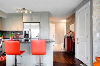 Photo 15: 15 West Coach Manor SW in Calgary: West Springs Row/Townhouse for sale : MLS®# A1100327