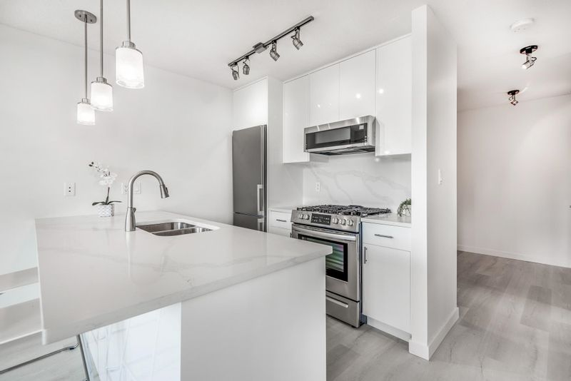 FEATURED LISTING: 609 - 1185 THE HIGH Street Coquitlam
