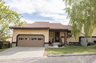 Main Photo: 21 118 Strathcona Road SW in Calgary: Strathcona Park Row/Townhouse for sale : MLS®# A1145503