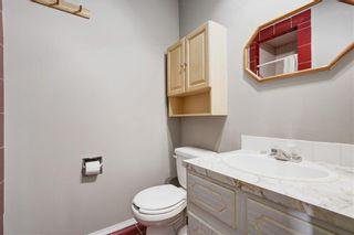 Photo 12: 304 QUEEN ANNE Way SE in Calgary: Queensland House for sale : MLS®# C4178496