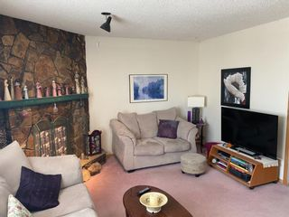 Photo 3: 937 38 Street SW in Calgary: Rosscarrock Detached for sale : MLS®# A1074460