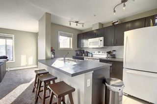 Photo 4: 2413 403 Mackenzie Way SW: Airdrie Apartment for sale : MLS®# A1052642