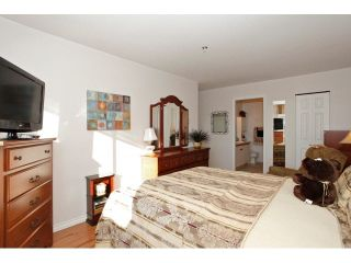 "Photo 12: 311 5955 177B Street in Surrey: Cloverdale BC Condo for sale in ""WINDSOR PLACE"" (Cloverdale)  : MLS®# F1433073"