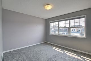 Photo 27: 566 River Heights Crescent: Cochrane Semi Detached for sale : MLS®# A1129968