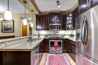 """Photo 5: A104 8218 207A Street in Langley: Willoughby Heights Condo for sale in """"Yorkson Creek - Walnut Ridge 4"""" : MLS®# R2590289"""