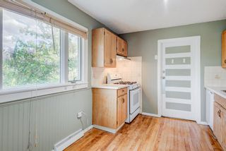Photo 12: 1401 19 Avenue NW in Calgary: Capitol Hill Detached for sale : MLS®# A1119819