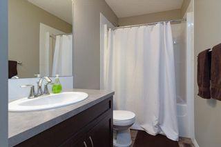 Photo 11: 306 FIRESIDE Place: Cochrane House for sale : MLS®# C4137461