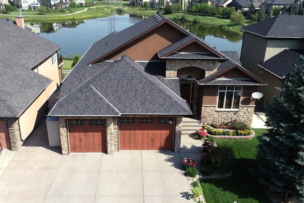 Executive Style Four bedroom bungalow backing onto the pond in Rainbow Falls!