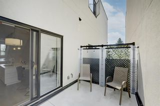 Photo 11: 109 15 Rosscarrock Gate SW in Calgary: Rosscarrock Row/Townhouse for sale : MLS®# A1130892