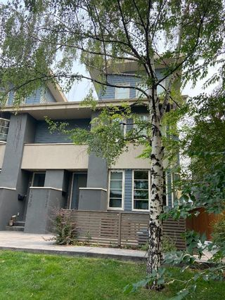 Main Photo: 2 1932 36 Street SW in Calgary: Killarney/Glengarry Row/Townhouse for sale : MLS®# A1135823