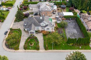 Photo 2: 5748 123 Street in Surrey: Panorama Ridge House for sale : MLS®# R2616639