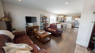"""Photo 2: 8320 88 Street in Fort St. John: Fort St. John - City SE 1/2 Duplex for sale in """"MATTHEWS PARK"""" (Fort St. John (Zone 60))  : MLS®# R2602097"""