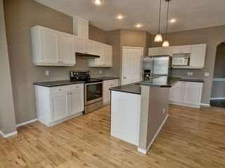 Photo 6: 305 Bayside Place SW: Airdrie Detached for sale : MLS®# A1116379