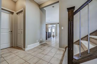 Photo 3: 26 BRIGHTONWOODS Bay SE in Calgary: New Brighton Detached for sale : MLS®# A1110362