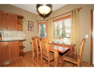 Photo 11: 18 WEST POINTE Manor: Cochrane House for sale : MLS®# C4072318